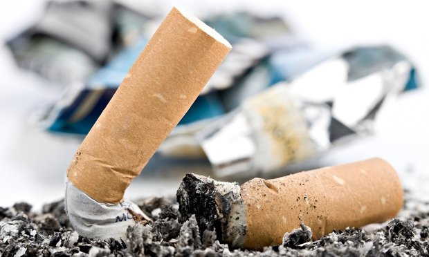 Two cigarette butts in an ashtray